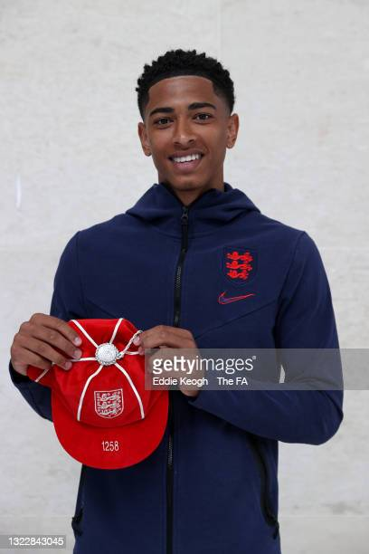 Jude Bellingham of England poses with an England legacy cap at St George's Park on June 08, 2021 in Burton upon Trent, England.