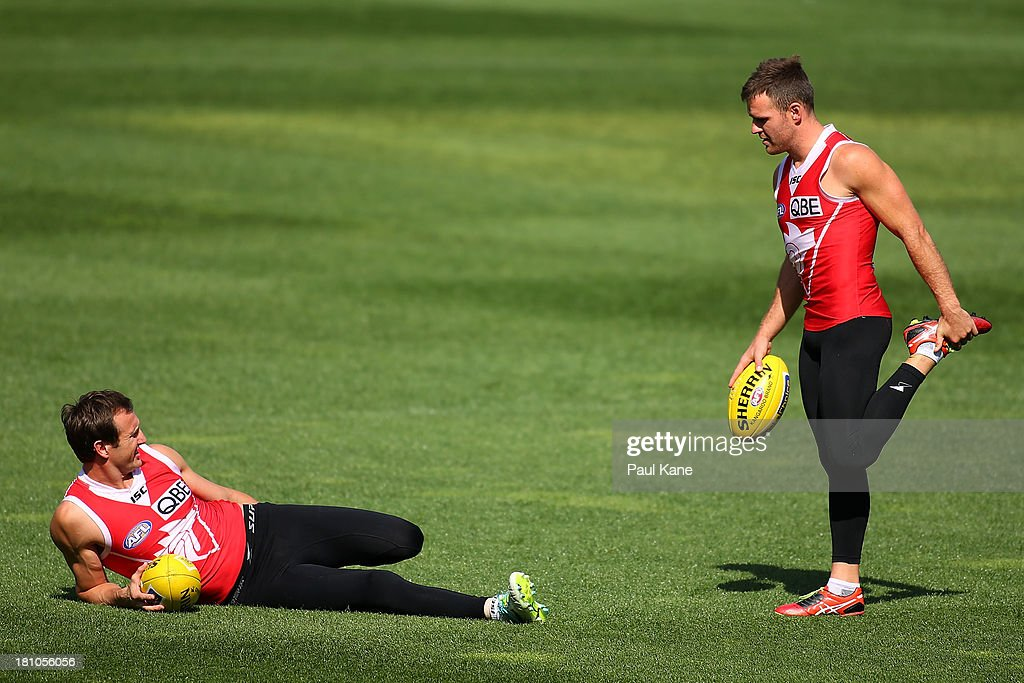 Jude Bolton and Ben McGlynn stretch during a Sydney Swans AFL training session at Patersons Stadium on September 19, 2013 in Perth, Australia.