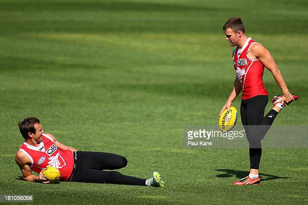 Jude Bolton and Ben McGlynn stretch during a Sydney Swans AFL training session at Patersons Stadium on September 19 2013 in Perth Australia