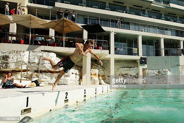 Jude Bolton dives into the pool during a Sydney Swans AFL recovery session at Bondi Icebergs Pool on August 5 2013 in Sydney Australia