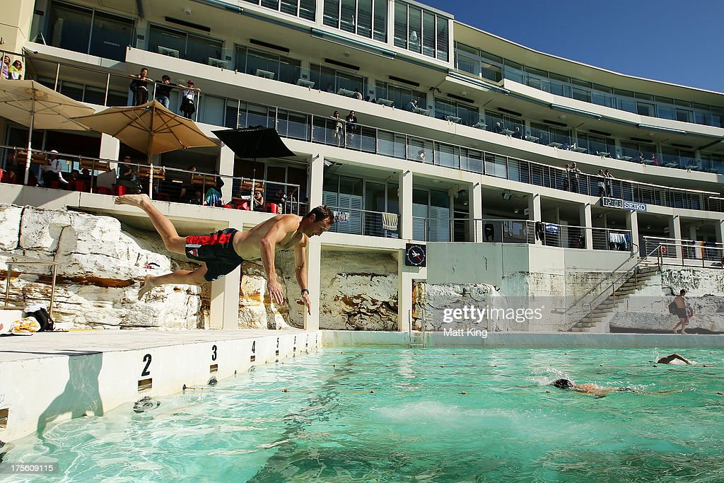 Jude Bolton dives into the pool during a Sydney Swans AFL recovery session at Bondi Icebergs Pool on August 5, 2013 in Sydney, Australia.
