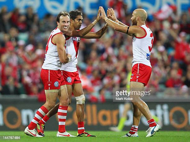 Jude Bolton Lewis Jetta and Jarrad McVeigh of the Swans celebrates after Jetta kicked a goal during the round eight AFL match between the Sydney...