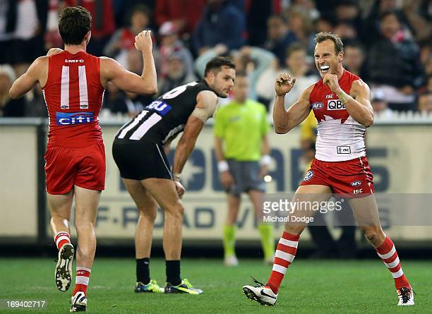 Jude Bolton of the Swans celebrates his goal after the final siren during an AFL match between the Collingwood Magpies and the Sydney Swans at...