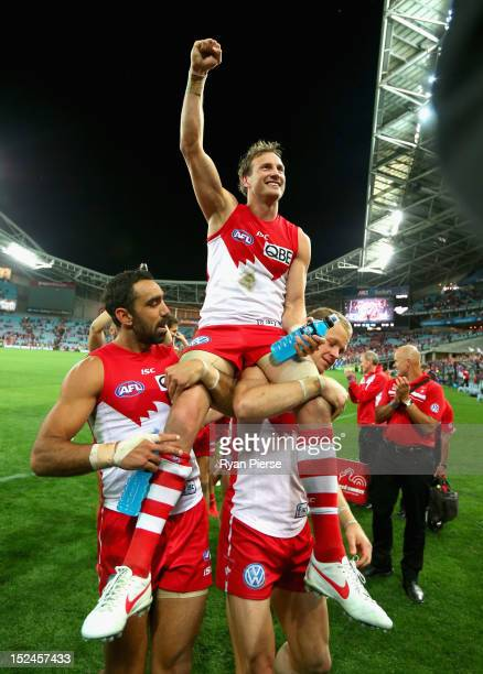 Jude Bolton of the Swans is chaired off after his 300th AFL match the second AFL Preliminary Final match between the Sydney Swans and the Collingwood...