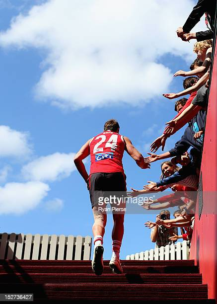 Jude Bolton of the Swans runs out onto the field during a Sydney Swans AFL training session at Sydney Cricket Ground on September 25 2012 in Sydney...