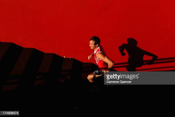Jude Bolton of the Swans runs up the players race during a Sydney Swans AFL training session at Sydney Cricket Ground on July 24 2013 in Sydney...