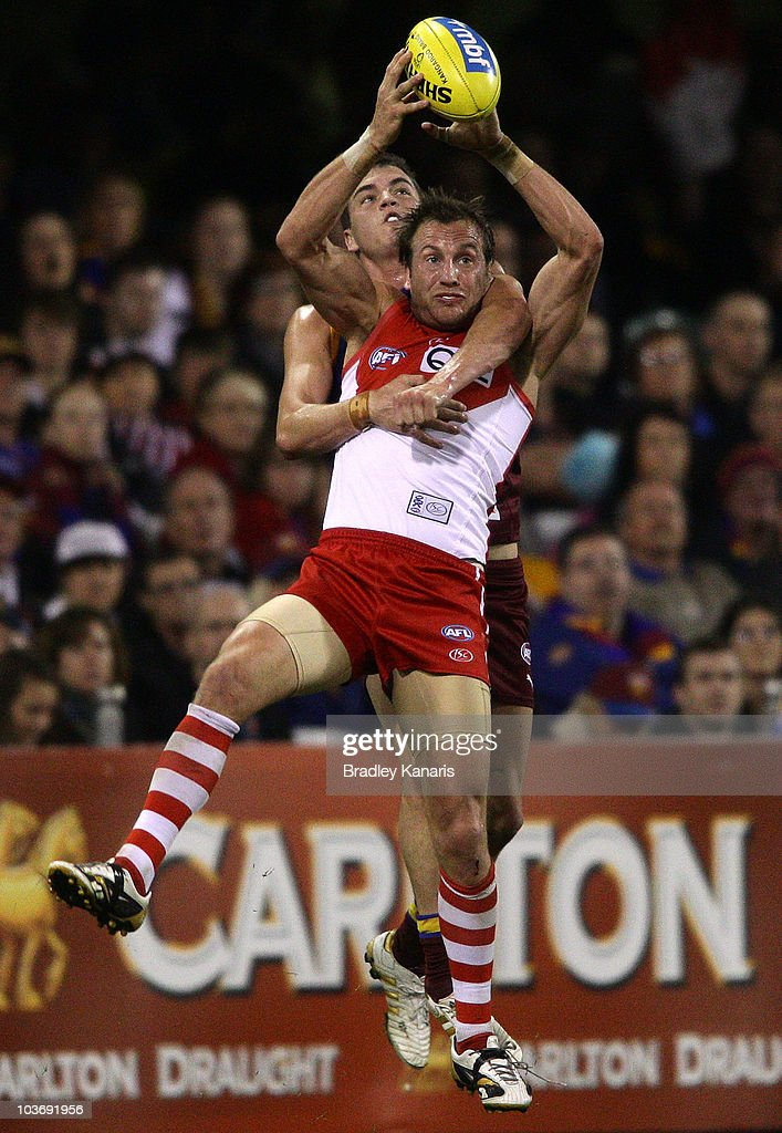 Jude Bolton of the Swans takes a mark during the round 22 AFL match between the Brisbane Lions and the Sydney Swans at The Gabba on August 28, 2010 in Brisbane, Australia.