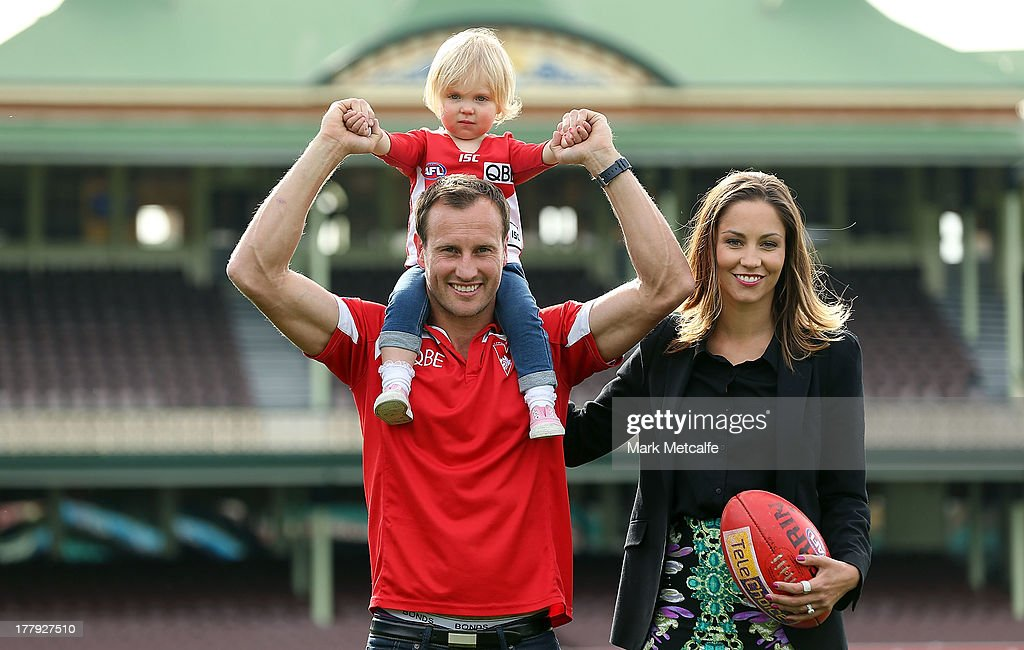 Jude Bolton poses with his wife Lynette and daughter Siarra after announcing his retirement at the end of the season during a Sydney Swans AFL press conference at the Sydney Cricket Ground on August 26, 2013 in Sydney, Australia.