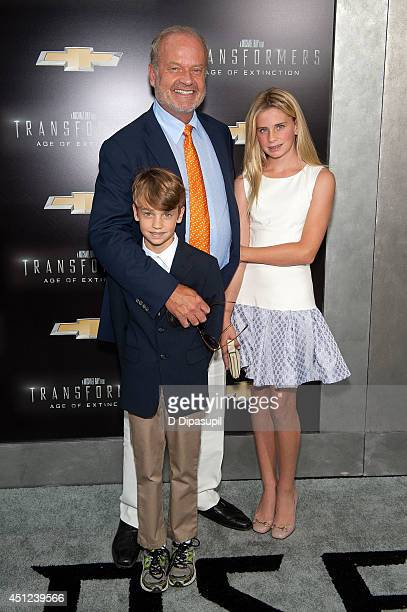Jude Grammer Kelsey Grammer and Mason Grammer attend the Transformers Age Of Extinction premiere at Ziegfeld Theater on June 25 2014 in New York City