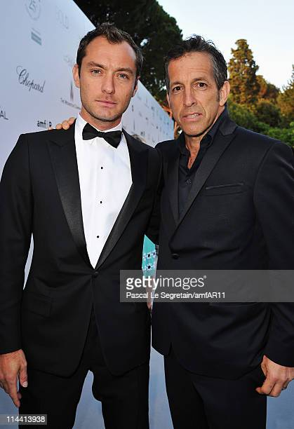 Jude Law and amfAR Chairman Kenneth Cole attend amfAR's Cinema Against AIDS Gala during the 64th Annual Cannes Film Festival at Hotel Du Cap on May...