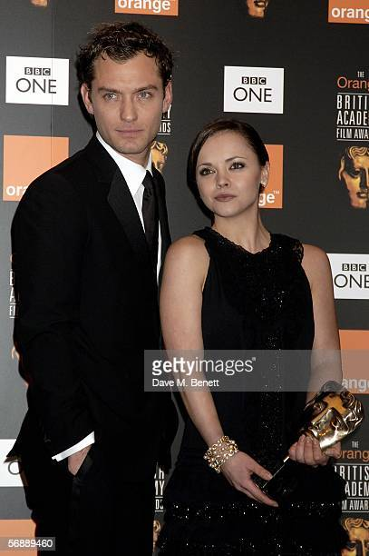 Jude Law and Christina Ricci pose backstage in the Awards Room with the award on behalf of Reese Witherspoon for Actress in a Leading Role for Walk...