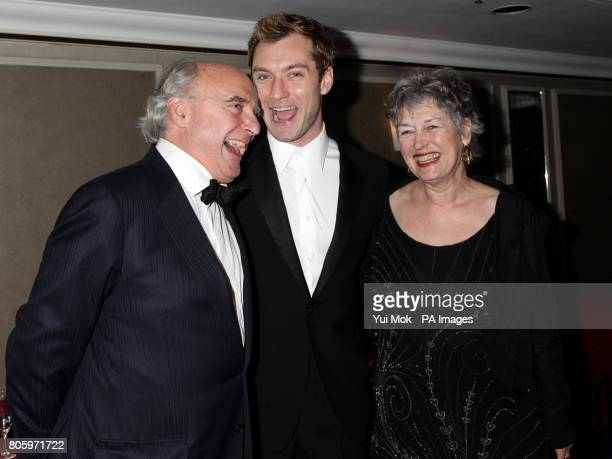 Jude Law and his parents Peter and Margaret arrive for the Laurence Olivier Awards at the Grosvenor House Hotel in central London