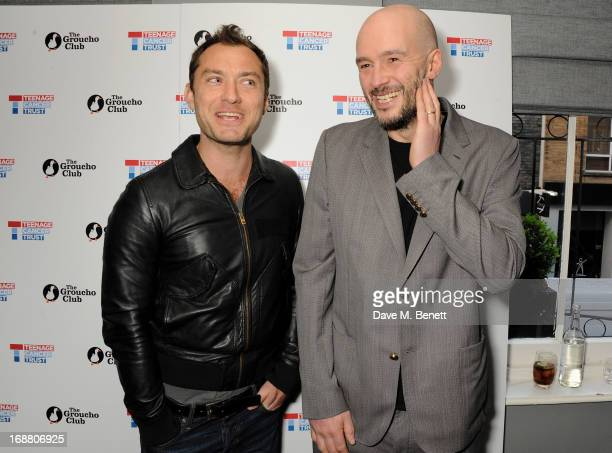 Jude Law and Jake Chapman attend the annual fundraising art auction in aid of Teenage Cancer Trust at The Groucho Club on May 15 2013 in London...