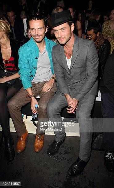 Jude Law and Matthew Willamson in the front row at the Twenty8Twelve S/S 2011 show at London Fashion Week at Old Sorting Office on September 18 2010...