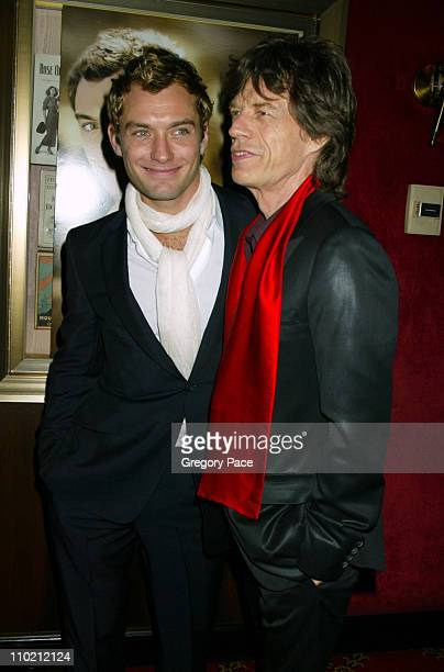Jude Law and Mick Jagger during Alfie New York Premiere Inside Arrivals at Ziegfield Theater in New York City New York United States