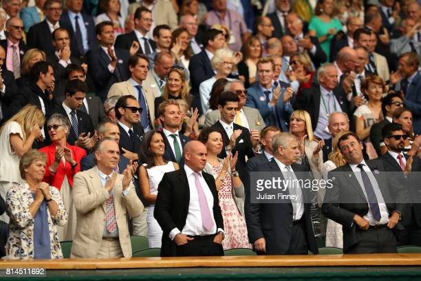 Jude Law and Nico Rosberg applaud from the royal box after the Gentlemen's Singles semi final match betwen Roger Federer of Switzerland and Tomas...