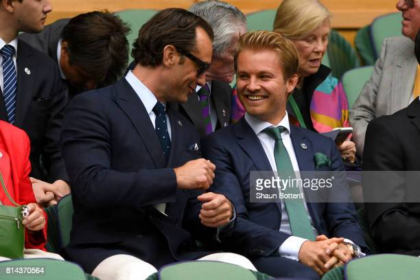 Jude Law and Nico Rosberg in discussion in the centre court royal box on day eleven of the Wimbledon Lawn Tennis Championships at the All England...