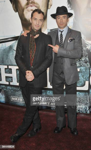 Jude Law and Robert Downey Jr attend the World Premiere of 'Sherlock Holmes' at Empire Leicester Square on December 14, 2009 in London, England.