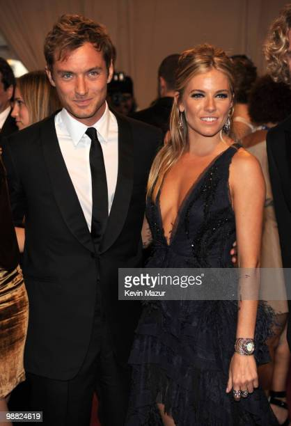 Jude Law and Sienna Miller attends the Costume Institute Gala Benefit to celebrate the opening of the 'American Woman Fashioning a National Identity'...