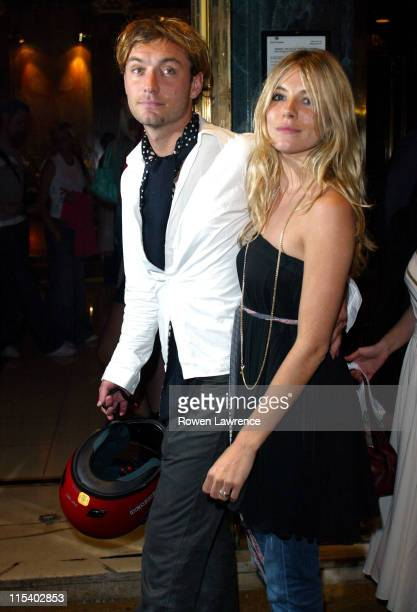 Jude Law and Sienna Miller during LIVE 8 - London - Official After Party at Elysium, Cafe Royal in London, Great Britain.