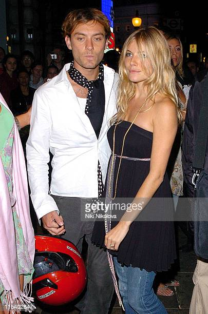 Jude Law and Sienna Miller during Live 8 London Official Aftershow Party at Elysium Cafe Royal in London United Kingdom