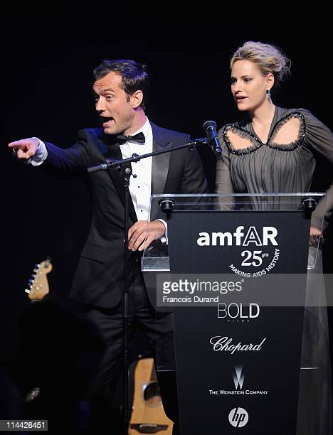 Jude Law appears onstage with Aimee Mullins at amfAR's Cinema Against AIDS Gala during the 64th Annual Cannes Film Festival at Hotel Du Cap on May...