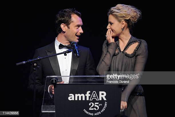 Jude Law appears onstage with Aimee Mullins at amfAR's Cinema Against AIDS Gala during the 64th Annual Cannes Film Festival at Hotel Du Cap on May 19...
