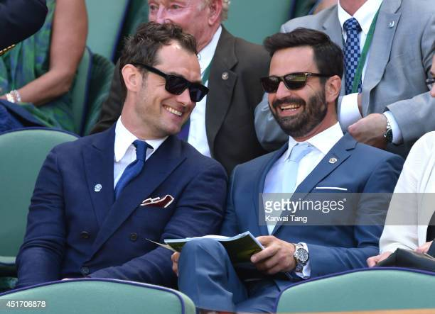 Jude Law attends the semifinal match between Novak Djokovic and Grigor Dimitrov on centre court at The Wimbledon Championships at Wimbledon on July 4...