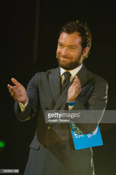 Jude Law introducing Jeremy Gilley at the Peace One Day Celebration 2012 at Wembley Arena on September 21 2012 in London England