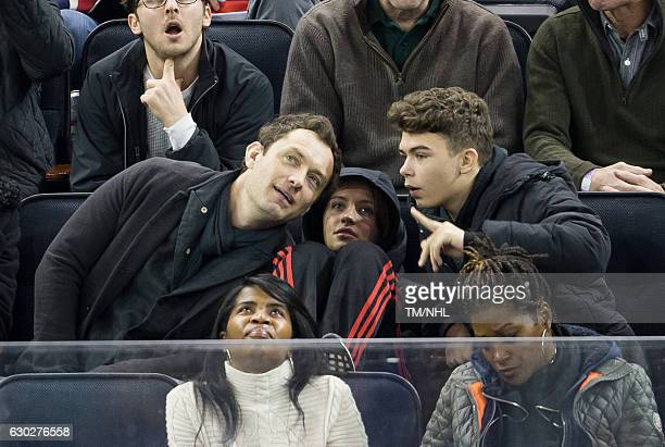 Jude Law, Iris Law, and Rudy Law are seen at Madison Square Garden on December 18, 2016 in New York City.