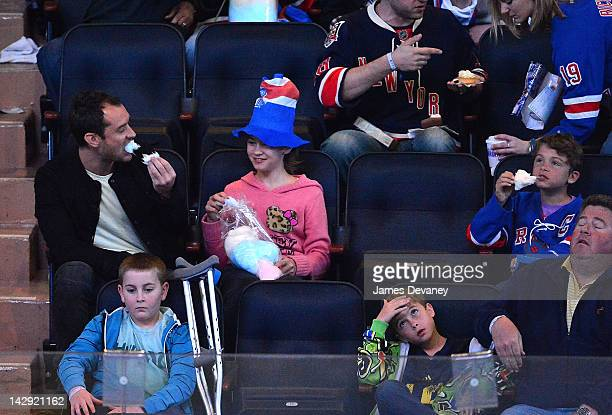 Jude Law Iris Law and Rudy Law attend the Ottawa Senators vs New York Rangers game at Madison Square Garden on April 14 2012 in New York City