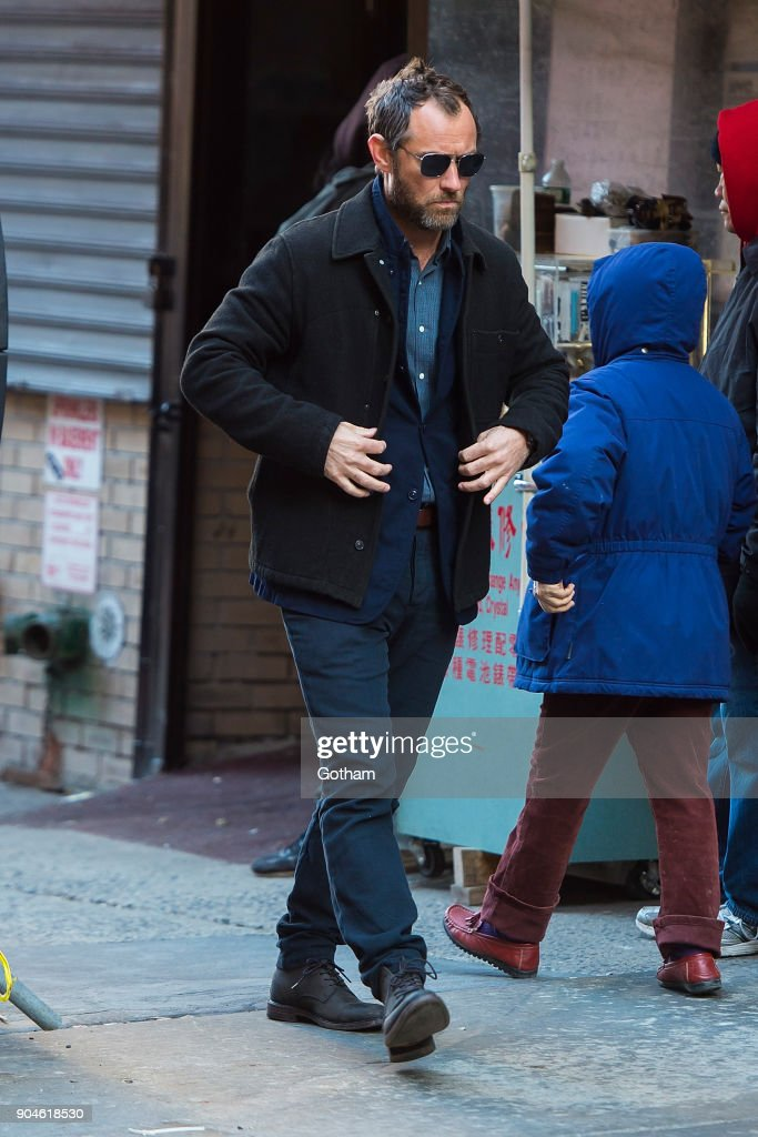 Jude Law is seen filming 'The Rhythm Section' in Chinatown on January 13, 2018 in New York City.