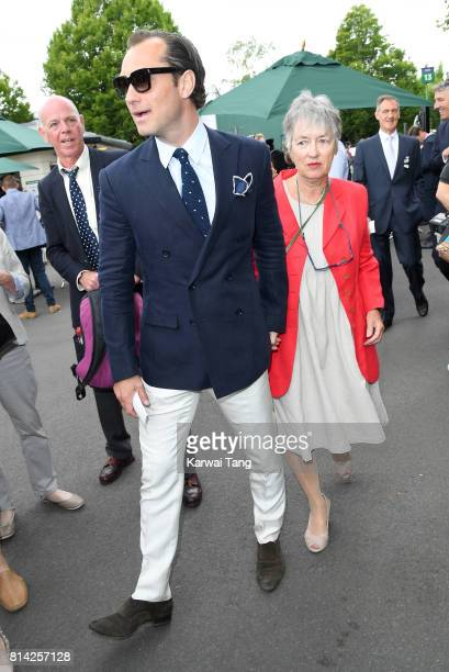 Jude Law with his mother Maggie Law attend day 11 of Wimbledon 2017 on July 14 2017 in London England