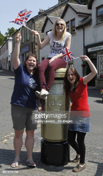 Jude Treliving Abi Rose and Lisa Clarke are pictured with an Olympic golden post box in Andy Murray's home town of Dunblane in Scotland ahead of the...