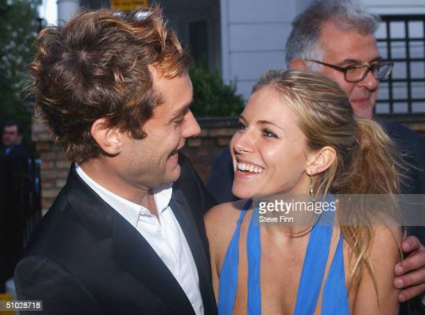 JudeLaw and Sienna Miller leave David Frost's Summer Party at Carlisle Square on July 6 2004 in London