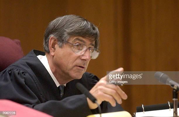 Judge Al Girolami gestures as he speaks with attorneys in Stanislaus Superior Courtroom June 6 2003 in Modesto California Murder suspect Scott...