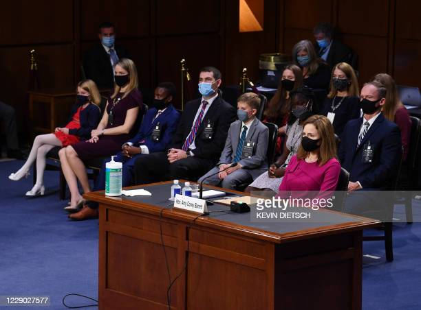 Judge Amy Coney Barrett listens to the start of the US Senate Judiciary Committee confirmation hearing on her nomination to serve as an associate...