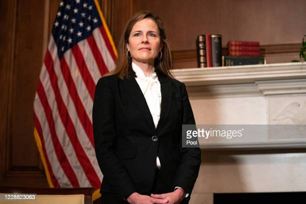 Judge Amy Coney Barrett, President Donald Trump's nominee for Supreme Court, poses for a photo before a meeting with Senator Steve Daines, R-Mont.,...