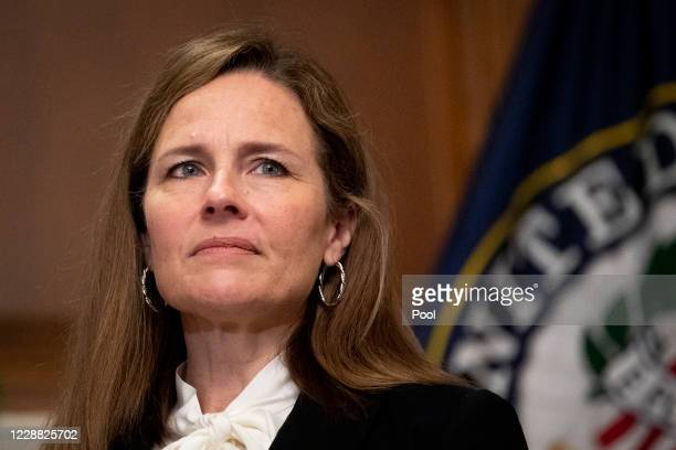 Judge Amy Coney Barrett, President Donald Trump's nominee to the Supreme Court meets with Sen. Joni Ernst at the U.S. Capitol on October 1, 2020 in...