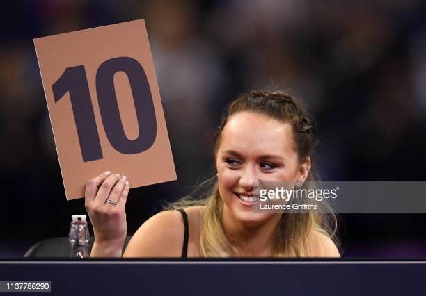 Judge Amy Tinkler awards Danusia Francis of Jamaica a '10' for her performance on balance beam during the Superstars of Gymnastics at The O2 Arena on...