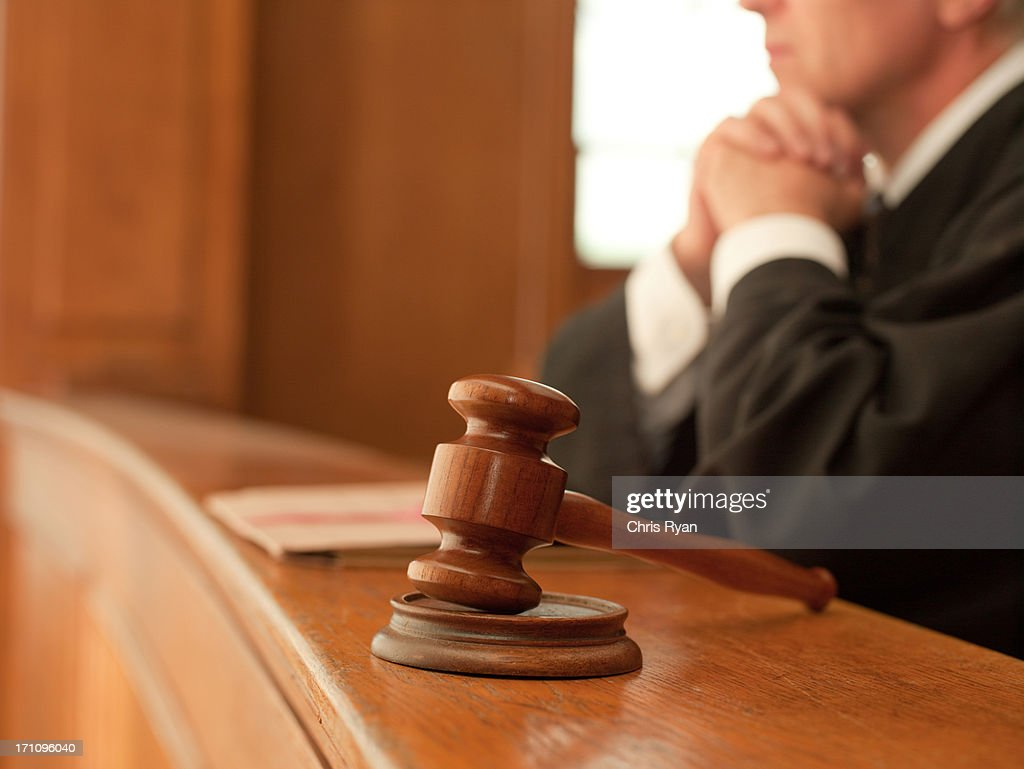 Judge and gavel in courtroom : Stock Photo