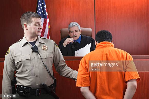 judge and prisoner in courtroom - criminal stock pictures, royalty-free photos & images