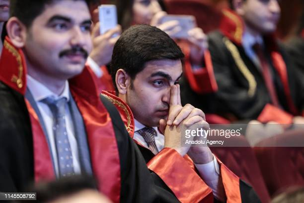 Judge and public prosecutor candidates wait for announcements during their draw ceremony at Bestepe People's Congress and Cultural Center in Ankara,...