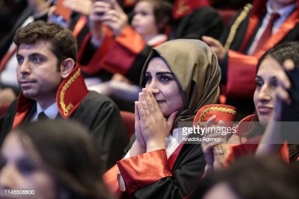 Judge and public prosecutor candidates wait for announcements during their draw ceremony at Bestepe People's Congress and Cultural Center in Ankara...