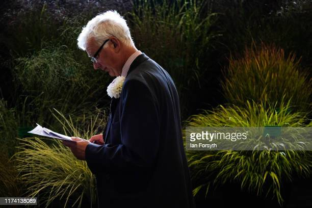 A judge assesses a display during staging day for the Harrogate Autumn Flower Show on September 12 2019 in Harrogate England The UK's premier Autumn...