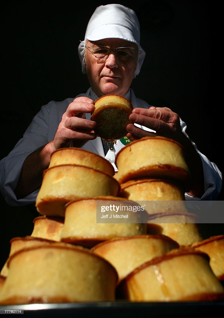 A judge at the World Scotch Pie Championship inspects a pie during judging at Lauder College November 7, 2007 in Dunfermline, Scotland. A total of 70 bakers and butchers will vie for the coveted title of World Scotch Pie Champion.