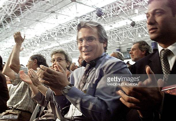 Judge Baltasar Garzon applauds during Noam Chomsky's speech during the second day of the World Social Forum in Porto Alegre Brazil which occurs from...