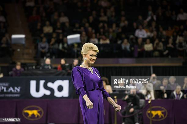 Judge Betty Regina Leininger reviews the seven finalists in the Best in Show category in the Westminster Dog Show on February 11, 2014 in New York...