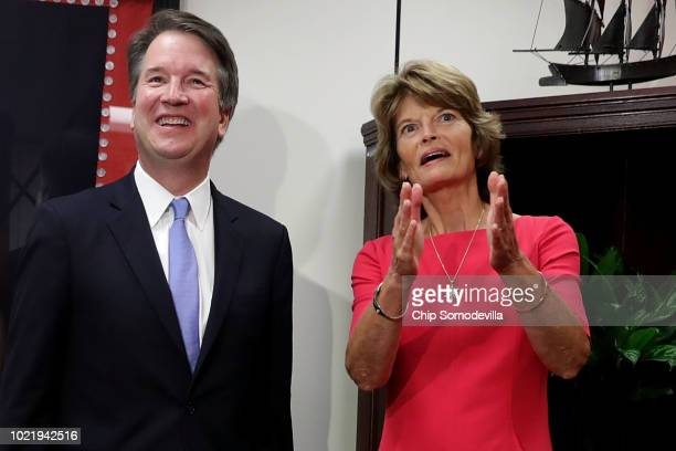 Judge Brett Kavanaugh and Sen Lisa Murkowski pose for photographs before their meeting in her Hart Senate Office Building office on Capitol Hill...