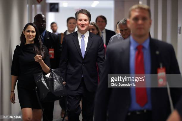 Judge Brett Kavanaugh is accompanied by his former clerk Zina Bash as they arrive at the offices of Sen Sheldon Whitehouse before a meeting in the...